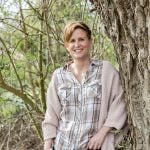 Connect with nature, Ruthy Doolittle standing against a tree